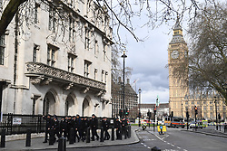 Police close to the Palace of Westminster, London, after policeman has been stabbed and his apparent attacker shot by officers in a major security incident at the Houses of Parliament.