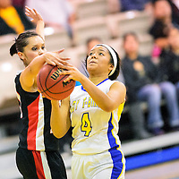 011514  Adron Gardner/Independent<br /> <br /> Crownpoint Eagle Becky Becenti (10), left,  gets a piece of a shot by Zuni Thunderbird Tamika Thompson (4) in Zuni Wednesday.