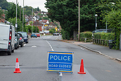 © Licensed to London News Pictures. 31/07/2021. High Wycombe, UK. A police cordon closes a road as a major investigation is underway in High Wycombe, unconfirmed reports on social media indicate that a person was stabbed to death in the early hours of Sunday morning 31 July 2021. Photo credit: Peter Manning/LNP