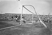 009/06/1963<br /> 06/09/1963<br /> 09 June 1963<br /> Soccer International: Ireland v Scotland at Dalymount Park Dublin. Ireland won the game 1-0 with a goal from Captain Noel Cantwell. A fast shot from Ireland's Noel Cantwell flashes past Scottish keeper Tommy Lawrence (on ground) in the first half.