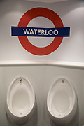 Amusing Waterloo sign in the toilets at London Transport Museum in London, England, United Kingdom. The London Transport Museum, or LT Museum based in Covent Garden, seeks to conserve and explain the transport heritage of Britains capital city. The majority of the museums exhibits originated in the collection of London Transport, but, since the creation of Transport for London, TfL, in 2000, the remit of the museum has expanded to cover all aspects of transportation in the city.