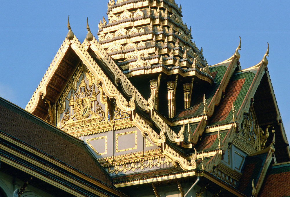 Detail of the ornately decorated roof of the Grand Palace in Bangkok, Thailand.
