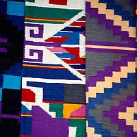 Central America, Guatemala, Antigua. Colorful woven textiles of Guatemala.