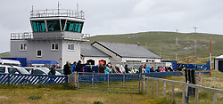 Barra Airport is a short-runway airport situated in the wide shallow bay of Traigh Mhòr at the north tip of the island of Barra in the Outer Hebrides, Scotland. Barra is now the only beach airport anywhere in the world to be used for scheduled airline services. Visitors to the island frequently come to watch the aircraft take off and land on the beach.(c) Stephen Lawson   Edinburgh Elite media