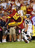 1 September 2007: #83 Fred Davis jumps over Idaho player during a touchdown drive at USC Trojans college football team defeated the Idaho Vandals 38-10 at the Los Angeles Memorial Coliseum in CA.  NCAA Pac-10 #1 ranked team first game of the season.