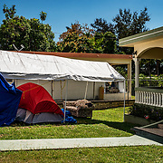 After a magnitude 6.4 earthquake in southern Puerto Rico (Magas Arriba) many families couldn't live in their damaged homes or feared aftershocks and built make-shift campsites for shelter.