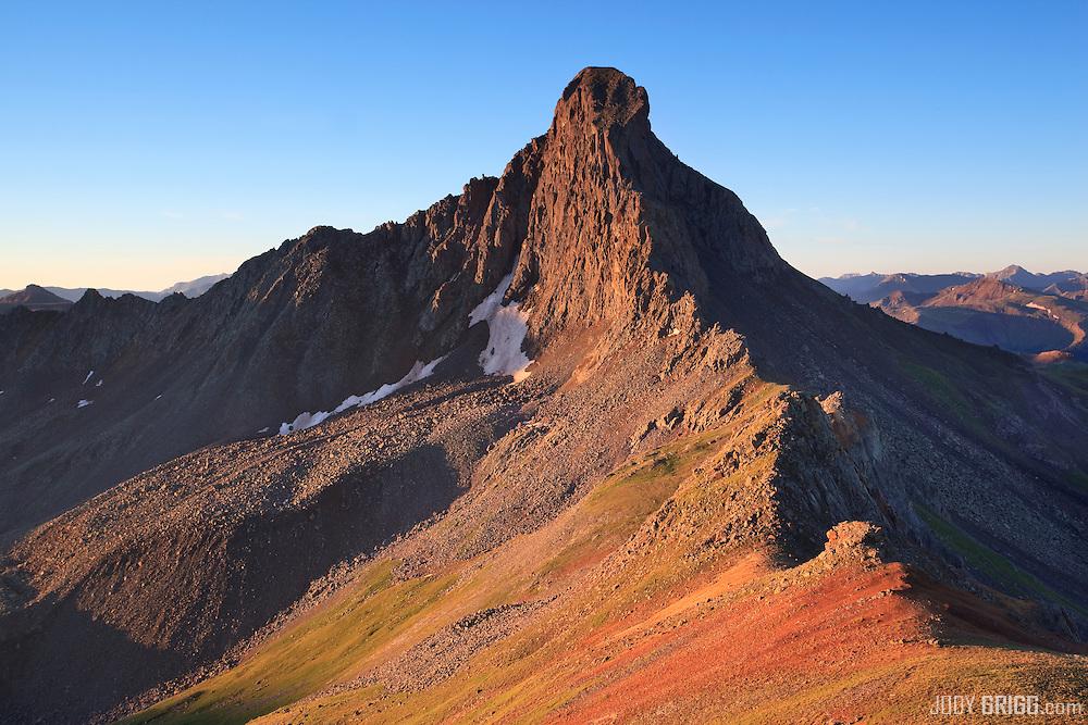 Sunrise strikes the northern flank of Wetterhorn Peak 14,015ft, San Juan mountains.