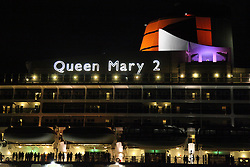 © Licensed to London News Pictures. 09/05/2014. Southampton, UK. The red funnel of the Queen Mary 2 cruise liner. Firework celebrations marking the 10-year anniversary of the Cunard flagship, Queen Mary 2, take place in the port of Southampton this evening, 9th May 2014. All 'three queens' of the Cunard fleet were present at the event, which included a 10-minute firework display, one minute for every year that the QM2 has been in service. Photo credit : Rob Arnold/LNP