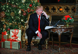 December 24, 2017 - Florida, U.S. - President Donald Trump and First Lady Melania Trump participated in NORAD Santa Tracker phone calls from Mar-a-Lago in Palm Beach Sunday afternoon, December 24, 2017. (Credit Image: © Bruce R. Bennett/The Palm Beach Post via ZUMA Wire)