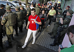 June 13, 2017 - Kiev, Ukraine - Representatives of the LGBT communities walk under the protection of the police to the opening of the Kiev Pride 2017 at Small Opera House in Kiev, Ukraine, on 13 June 2017. The LGBT Equality March or Kiev Pride 2017 parade will be held in Kiev on June 18. (Credit Image: © Serg Glovny via ZUMA Wire)