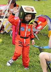 A boy repurposes a box as the helmet to his astronaut costume while waiting with his family on the lawn at the end of Main Street in Titusville, FL, USA, on Wednesday, May 27, 2020. The crowd was awaiting the SpaceX and NASA rocket launch of two astronauts from the nearby Kennedy Space Center, which was postponed due to weather. Photo by Stephen M. Dowell/Orlando Sentinel/TNS/ABACAPRESS.COM