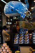 "Yushin wale meat shop Asakusa, Tokyo. In the photograph you can see a toy whale perched a shelf containing tinned whale meat, selling for about US$4-6. In the background left is a potential customer and child. To the right is a member of staff.....Next door is a whale meat restaurant, also called Yushin. The meat for both premises comes from the factory vessel Nisshin Maru, which carries out controversial ""scientific whaling research"" in the Southern Ocean every year, killing hundreds of whales in the Southern Ocean Whale Sanctuary. After the whaling fleet arrive back in Japan, the whale meat is sold off to shops like Yushin. Critics, such as Greenpeace, say that the scientific research programme is really just commercial whaling in disguise."