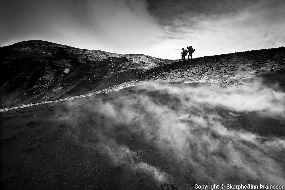 Hikers on the new mountain Magni/Móði in Goðahraun, while the ground is still hot few months after the eruptions on Fimmvörðuháls, south Iceland