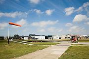 Nederland, Noord-Holland, Texel, 14-07-2008; vliegveld Texel, Texel airport; internationaal vliegveld 'De Vlijt'; windzak (windwijzer, windvaan);  helikopter van  het type Hughes 300 wordt getankt; brandstof kerosine; het vliegveld wordt veel gebruikt voor parachute springen, paracentrum.luchtfoto (toeslag); aerial photo (additional fee required); .foto Siebe Swart / photo Siebe Swart
