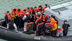 © Licensed to London News Pictures. 22/09/2021. Dover, UK.  Migrants arriving by boat at Dover Harbour in Kent. Migrants are continuing to attempt the crossing from France as the weather improves this week. Photo credit: Stuart Brock/LNP