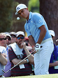 April 6, 2018 - Augusta, GA, USA - Rickie Fowler chips to the green on six during the second round of the Masters Tournament Friday, April 6, 2018, at Augusta National Golf Club on Friday, April 6, 2018, in Augusta, Ga. (Credit Image: © Jason Getz/TNS via ZUMA Wire)
