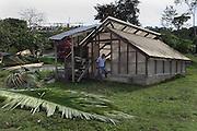 TCGA Compliance Coordinator Abner Cal exits a cacao-bean drying structure. Toledo Cacao Growers' Association (TCGA), San Jose, Toledo, Belize. January 25, 2013.