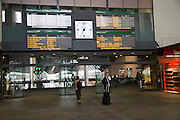 Electronic clock and display of travel information inside Santa Justa railway station, Seville, Spain
