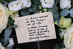 © Licensed to London News Pictures. 16/03/2019. London, UK. Jeremy Corbyn's message and floral tribute<br /> at the entrance of High Commission of New Zealand in London. A gunman killed 49 worshippers at the Al Noor Masjid and Linwood Masjid mosques in Christchurch, New Zealand on 15 March. The 28-year-old Australian suspect, Brenton Tarrant, appeared in court on 16 March and was charged with murder. Photo credit: Dinendra Haria/LNP