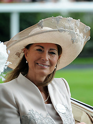 Carole Middleton takes part in the traditional horse-drawn carriage procession during Ladies Day at Royal Ascot on June 16, 2011.
