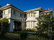 """05 NOVEMBER 2015 - YANGON, MYANMAR: The home of Aung San Suu Kyi. She lived in house arrest here for more than 15 years. Suu Kyi is now contesting a national election in Myanmar and hosted a press conference at her home. During the press conference, which lasted 90 minutes, Aung San Suu Kyi, the leader of the National League for Democracy (NLD), said that if the NLD won the election she would serve """"above"""" the President. When questioned about the Rohingya crisis in western Myanmar, a reporter called the situation """"dramatic"""" and Suu Kyi replied the entire country is in a """"dramatic situation"""" and the problems of the Rohingya should not be """"exaggerated."""" She said the """"great majority of our people remain as poor as ever."""" She also said the NLD would make a """"fuss"""" if election results were """"suspicious."""" Citizens of Myanmar go to the polls Sunday November 8 in what is widely viewed as the most democratic and contested election in Myanmar's history. The NLD is widely expected to win the election.    PHOTO BY JACK KURTZ"""