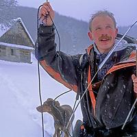 ROMANIA. Biologist Peter Suerth and his dog track a radio-collared wolf in the Transylvanian Alps (Carpathian Mountains) near Zarnesti