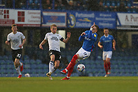 Football - 2020 / 2021 Sky Bet League One - Portsmouth vs. Peterborough United - Fratton Park<br /> <br /> Louis Reed of Peterborough and Portsmouth's Ronan Curtis in action during the League One fixture at Fratton Park <br /> <br /> COLORSPORT/SHAUN BOGGUST