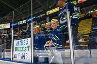 KELOWNA, BC - SEPTEMBER 29:  Fans of Darren Archibald #49 of the Vancouver Canucks wait at the glass for warm up against the Arizona Coyotes at Prospera Place on September 29, 2018 in Kelowna, Canada. (Photo by Marissa Baecker/NHLI via Getty Images)  *** Local Caption *** Darren Archibald