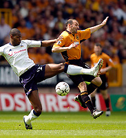 Photo. Jed Wee, Digitalsport<br /> NORWAY ONLY<br /> <br /> Wolverhampton Wanderers v Tottenham Hotspurs, FA Barclaycard Premiership, 15/05/2004.<br /> Wolves' Colin Cameron (R) and Spurs' Anthony Gardner challenge for possession.