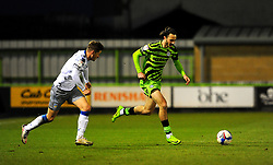 Josh Doherty of Colchester United chases down Aaron Collins of Forest Green Rovers - Mandatory by-line: Nizaam Jones/JMP - 27/02/2021 - FOOTBALL - The innocent New Lawn Stadium - Nailsworth, England - Forest Green Rovers v Colchester United - Sky Bet League Two