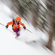 Lynsey Dyer motion blurred in the Teton backcountry of Wyoming.