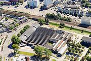 Nederland, Noord-Brabant, Tilburg, 23-08-2016; centrum van Tilburg, omgeving station. NS plein met Koepelhal. Voormalige Hoofdwerkplaats bvan de Nederlandse Spoorwegen. City centre, environment railway station.<br /> luchtfoto (toeslag op standard tarieven);<br /> aerial photo (additional fee required);<br /> copyright foto/photo Siebe Swart