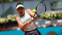 May 7, 2019 - Madrid, Spain - SIMONA HALEP of Romania in action against Johanna Konta of Great Britain during their second-round match at the 2019 Mutua Madrid Open. Halep won 7:5, 6:1.  (Credit Image: © AFP7 via ZUMA Wire)