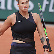 PARIS, FRANCE June 4.  Aryna Sabalenka of Belarus kicks out at her tennis racket after throwing it to the floor during her loss against Anastasia Pavlyuchenkova of Russia on CourtSimonne Mathieu during the third round of the singles competition at the 2021 French Open Tennis Tournament at Roland Garros on June 3rd 2021 in Paris, France. (Photo by Tim Clayton/Corbis via Getty Images)