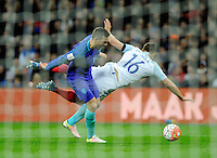 England's Phil Jagielka is tackled by Holland's Vincent Janssen - a challenge that England players protested about in the lead up to the winning goal<br /> <br /> Photographer AshleyWestern/CameraSport<br /> <br /> Football - Breast Cancer Care International Friendly - England v Holland - Tuesday 29th March 2016 - Wembley Stadium - London<br /> <br /> © CameraSport - 43 Linden Ave. Countesthorpe. Leicester. England. LE8 5PG - Tel: +44 (0) 116 277 4147 - admin@camerasport.com - www.camerasport.com
