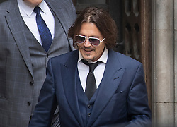© Licensed to London News Pictures. 07/07/2020. London, UK. US actor Johnny Depp smiles as he leaves The High Court in Central London. Johnny Depp's libel trial against The Sun newspaper is due to take place over the next three weeks over allegations he was violent and abusive towards his ex-wife Amber Heard. Photo credit: Peter Macdiarmid/LNP