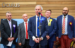 © Licensed to London News Pictures. 09/06/2017. Aylesbury, UK.  David Lidington (Conservative) (C)reacts after being announced as the winner of the Aylesbury constituency in the 2017 general election. Also in this picture (L to R): Kyle Michael (Independent), Mark Bateman (Labour), Steven Lambert (Liberal Democrats), Vijay Singh Srao (UKIP).  Photo credit: Cliff Hide/LNP