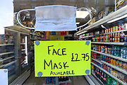 A surgical protective mask is displayed on a local off-licence shop in central London for over £2 on Sunday, March 22, 2020. Many people (mainly Asians) are seen wearing face protective masks against Coronavirus pandemic that spread across the world within 12 weeks.<br /> For most people, the new coronavirus causes only mild or moderate symptoms, such as fever and cough. For some, especially older adults and people with existing health problems, it can cause more severe illness, including pneumonia.  (Photo/Vudi Xhymshiti)