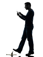 one man careless man walking on the telephone in silhouette studio on white background