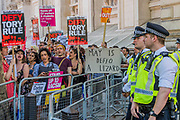 The protest moved down Whitehall and briefly stopped outside Downing Street which was protected by a police cordon - A day after the election result protestors gather to ask for Theresa May to quit and not do a deal with the DUP. Who people fear because of their views on abrtion, gay marriage etc. Westminster, London, 10 Jun 2017