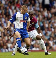 Fotball<br /> England 2005/2006<br /> Foto: SBI/Digitalsport<br /> NORWAY ONLY<br /> <br /> West Ham Utd v Blackburn Rovers<br /> Barclaycard Premiership.<br /> 13/08/2005.<br /> <br /> Andy Todd the Blackburn goalscorer shields the ball from Marlon Harewood