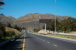 """A digital display reads: """"Provincial border closed to non-essentials"""" on the N2 from Strand toward Sir Lowry's Pass and Grabouw, in the Western Cape, South Africa, on Saturday, April 18, 2020. The South African government has shut down the country in response to Coronavirus, asking everyone but essential workers to stay home. PHOTO: EVA-LOTTA JANSSON<br /> [This is one is a series of landscapes shot in the Western Cape, South Africa, during the national ockdown in response to the Coronavirus.]"""