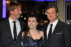 © licensed to London News Pictures. 16/02/2011. Director Tom Hooper, Helena Bonham and Colin Firth pose for photographs at the 61st Berlin Film Festival ahead of the Oscars in 10 days time where the movie hopes to win many awards including best actor for Firth and Best Movie..Photo credit should read Theodore Wood/LNP