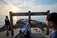 Visitors gather at sunset at the northernmost tip of Borneo, located in the Malaysian state of Sabah. <br /><br />(August 12, 2019)
