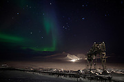 A green, purple and blue aurora borealis (northern light) is manifesting above the Russian coal mining community of Barentsburg, in the Norwegian Arctic archipelago of Svalbard.