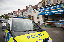 © Licensed to London News Pictures. 27/04/2020. London, UK. A police car is parked next to a crime scene outside an address on Aldborough Road North in Ilford where ,last night, two children were stabbed to death and a 40 year old man suffered knife injuries  . Photo credit: George Cracknell Wright/LNP