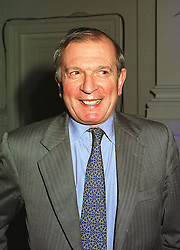 Journalist MR NIGEL DEMPSTER, at a party in London on 9th December 1998.<br /> MMU 26