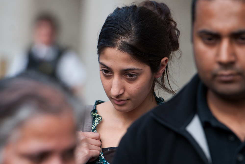Mundill Mahil leaves the Old Bailey surrounded by family  after being found guilty of GBH with intent  on February 24th 2012..Student Mahil will be sentenced for her part for the death of Gagandip Singh, 21, after he was beaten, put in a car, driven to London and set on fire..Mahil will be sentenced on Wednesday 29th at The Old Bailey..Photo Ki Price..