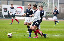 Falkirk's Mark Millar brought down for their penalty.<br /> Dundee 0 v 1 Falkirk, Scottish Championship game played today at Dundee's Dens Park.<br /> © Michael Schofield.