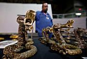 A vendor waits for customers of his real western diamondback rattlesnake souvenirs during the 51st Annual Sweetwater Texas Rattlesnake Round-Up March 13, 2009 in Sweetwater, Texas. During the three-day event approximately 240,000 pounds of rattlesnake will be collected, milked and served to support charity.